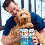 Backcountry Brewing   Throw Me A Frickin Bone Here   Pale Ale - Man with dog and a pack of cans